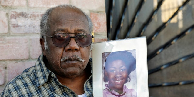 """Porter Alexander holds a photo of his daughter, an alleged victim of the """"Grim Sleeper"""" serial killer."""
