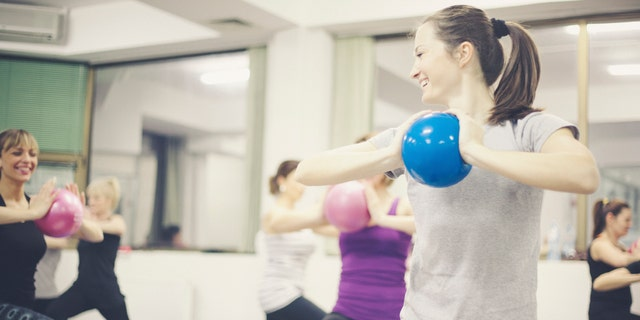 Group portraits of women doing pilates fitnes. Shallow DOF. Developed from RAW; retouched with special care and attention; Adobe RGB color profile.