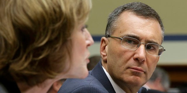 """Obamacare consultant Jonathan Gruber (R) listens to Centers for Medicare and Medicaid Services Administrator Marilyn Tavenner during testimony before a U.S. House Oversight and Government Reform hearing on """"Examining Obama Transparency Failures"""" in Washington December 9, 2014. Gruber apologized on Tuesday for his recent remarks about """"the stupidity of the American voter,"""" telling a congressional committee he did not think President Barack Obama's signature healthcare law was passed in a deceptive manner. REUTERS/Gary Cameron (UNITED STATES - Tags: POLITICS HEALTH) - RTR4HBJA"""