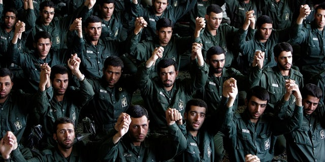 Members of the Iranian Revolutionary Guard Corps pray in Tehran.