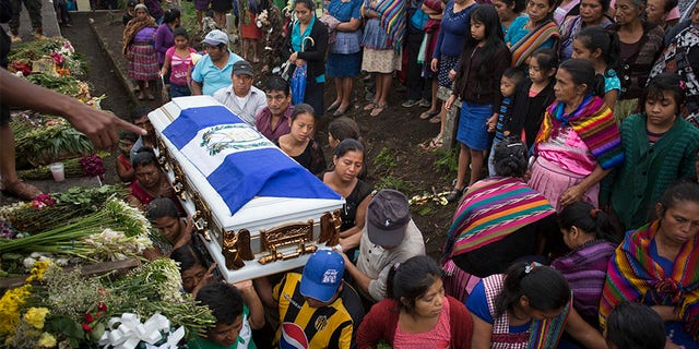 June 6, 2018: Family members of Erick Rivas, 20, who died in the hospital after suffering burns from the eruption of the Volcan de Fuego, carry his remains to the cemetery in San Juan Alotenango, Guatemala.