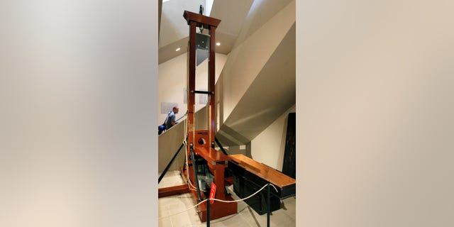 A model guillotine on display in Switzerland.