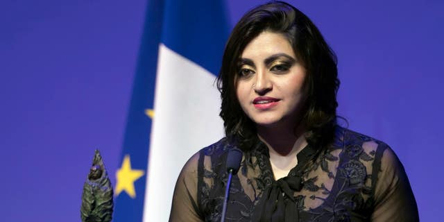 Pakistan's Gulalai Ismail delivers an acceptance speech after being awarded the Prize for Conflict Prevention for the work of her organization 'Aware Girls' promoting women's issues and equality in Pakistan at the Musee Branly in Paris, France, November 24, 2016.