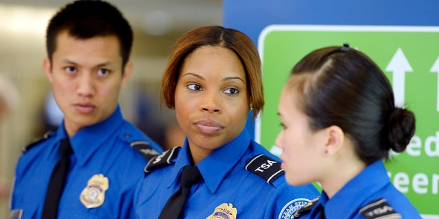 Feb. 21, 2014: Transportation Security Administration (TSA) agents wait for the arrival of Homeland Security Secretary Jeh Johnson at Los Angeles International Airpor