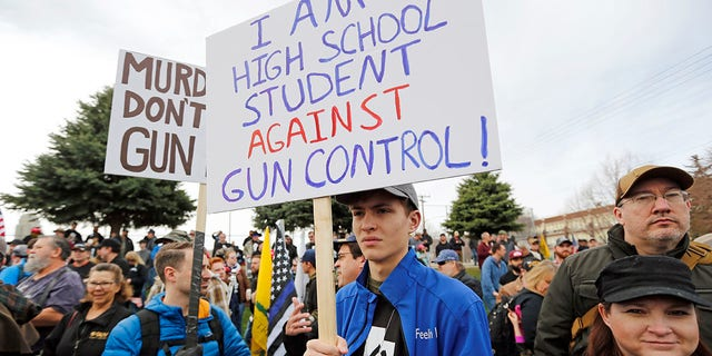 Levi Rodas, 16, from Orem High School, is shown during a pro-gun march designed by organizers to advocate for fortified schools and more armed teachers, in Salt Lake City, March 24, 2018.