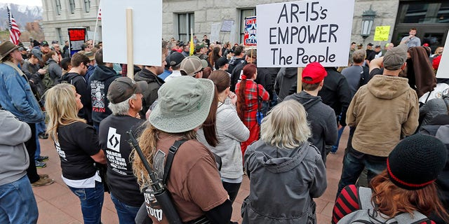Pro-gun marchers gather during a rally designed by organizer to advocate for fortified schools and more armed teachers, in Salt Lake City, March 24, 2018.