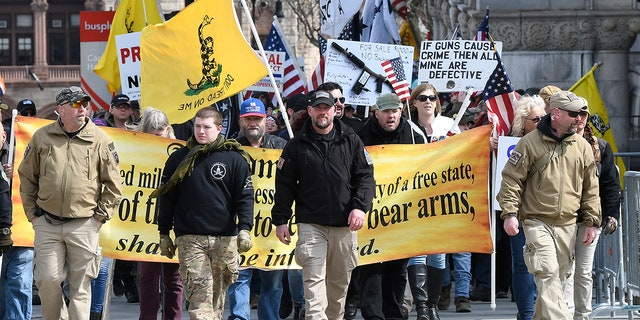 Gun rights activists with the National Constitutional Coalition of Patriotic Americans take part in a national rally aimed at pushing back against calls for stronger gun control measures outside the state Capitol Saturday in Albany, N.Y.