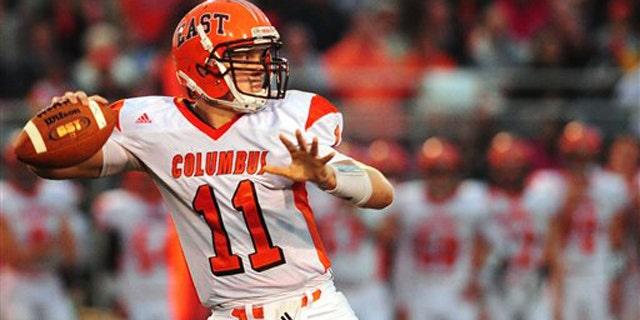 Sept. 9, 2011: This photo shows Columbus East quarterback Gunner Kiel dropping back to pass in the second quarter of a highs chool football game against Jennings County in North Vernon, Ind.