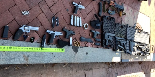 Weapons found in Bates' vehicle after a police search.