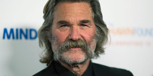 Kurt Russell believes in the right to bear arms, in real life and as Snake Plissken. (Reuters)