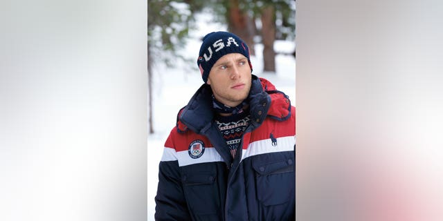 "Athletes such as skiier Gus Kenworthy, seen above, need merely to push a button on an accompanying electronic device to experience either high or low heating, which Ralph Lauren describes as ""immediate."""