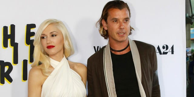 Gavin Rossdale (right) and his ex-wife Gwen Stefani pose at the premiere of