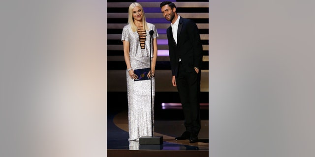 Gwen Stefani and Adam Levine present the award for Outstanding Variety Series onstage during the 66th Primetime Emmy Awards in Los Angeles, California August 25, 2014.