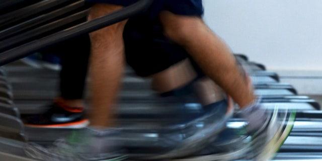 Apr 13, 2015: Men jog on treadmills inside a gym. (Reuters)