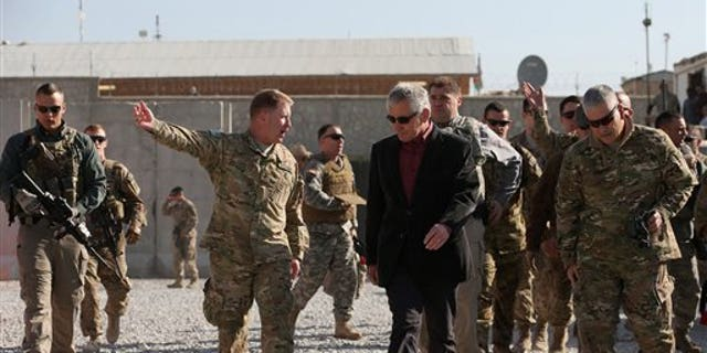 Dec. 7, 2014: U.S. Secretary of Defense Chuck Hagel, center, is escorted by U.S. Army Brigadier General Christopher F. Bentley, center left, after his arrival at Tactical Base Gamberi in eastern Afghanistan.