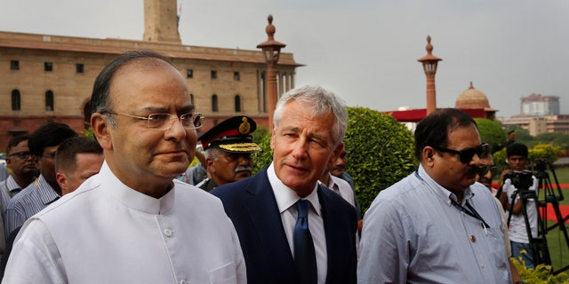 Aug. 8, 2014: U.S. Defense Secretary Chuck Hagel, center, talks with Indian Defense Minister Arun Jaitley as they walk for a meeting in New Delhi, India.