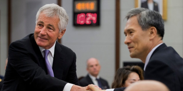 Oct. 2, 2013: U.S. Secretary of Defense Chuck Hagel, left, and South Korean Defense Minister Kim Kwan-jin, shake hands for a photograph at the 45th Security Consultative Meeting at Dfense Ministry in Seoul, South Korea.