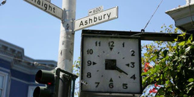In this Monday, May 22, 2017 photo, a clock remains stuck at 4:20 on the corner of Haight and Ashbury streets in San Francisco. They came for the music, the mind-bending drugs, to resist the Vietnam War and 1960s American orthodoxy, or simply to escape summer boredom. And they left an enduring legacy. Fifty years ago, throngs of American youth descended on San Francisco to join a cultural revolution. (AP Photo/Eric Risberg)