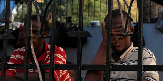 Prisoners are seen at a temporary prison at a street corner in Port-au-Prince, Haiti.
