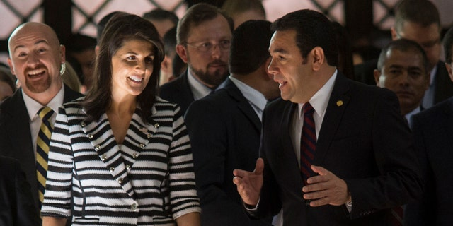 Nikki Haley, U.S. ambassador to the U.N., left, walks with Guatemala's President Jimmy Morales after their meeting at the National Palace of Culture in Guatemala City, Wednesday, Feb. 28, 2018.