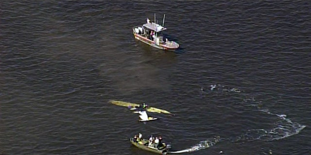 Rescue boats surround the wreckage of the plane Halladay was flying Tuesday.