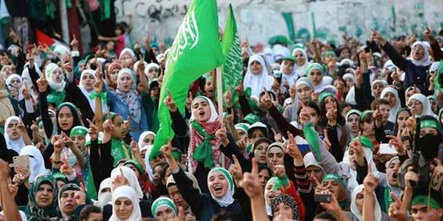 Hamas supporters rally in the West Bank, where Palestinian Authority officials say the terror group is seeking to undermine it, with help from an operative in Turkey. (Reuters)