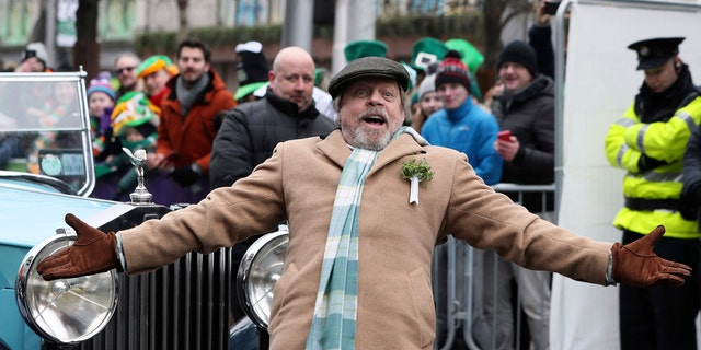 US actor Mark Hamill gestures as he attends the St Patrick's day parade, in Dublin,  Saturday March 17, 2018. (Brian Lawless/PA via AP)