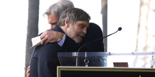 Fords hugs Hamill after his speech about his long-time costar and friend.