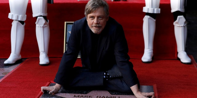 Mark Hamill poses with his new Hollywood Walk of Fame star.