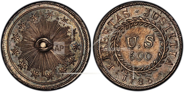 """This image provided by PCGS.com/Professional Coin Grading Service shows the front, left, and back of a 1783 plain obverse Nova Constellatio """"Quint"""" silver coin. Authorized by Congress, the coin had a value of 500 units in a proposed but later abandoned early American decimal monetary system that would have ranged from 5 to 1,000 units. (Courtesy of PCGS.com via AP)"""