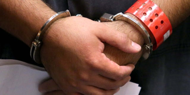 SANFORD, FL - NOVEMBER 19:  Detail of the handcuffed hands of George Zimmerman, the acquitted shooter in the death of Trayvon Martin, faces a Seminole circuit judge during a first-appearance hearing on charges including aggravated assault stemming from a fight with his girlfriend November 19, 2013 in Sanford, Florida. Zimmerman, 30, was arrested after police responded to a domestic disturbance call at a house. He was acquitted in July of all charges in the shooting death of unarmed, black teenager, Trayvon Martin.   (Photo by Joe Burbank-Pool/Getty Images)