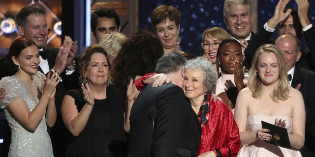 "Atwood celebrates ""The Handmaid's Tale"" Best TV Drama win at the 2017 Emmy Awards with the show's cast."