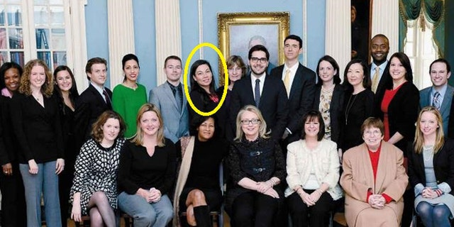 """Monica Hanley, pictured standing in the back row right behind Hillary Clinton aide Cheryl Mills in a State Department photo from Clinton's book """"Hard Choices."""""""