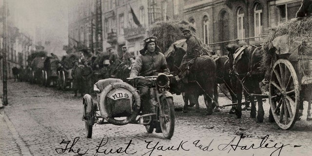 American soldier Roy Holtz rides a motorcycle in Germany the day after WWI ends, according to Harley-Davidson Archives.