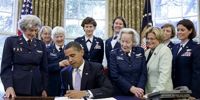 July 1, 2009: President Obama signS S.614, a bill to award a Congressional Gold Medal to the Women Airforce Service Pilots, in the Oval Office. At second left is WASP pilot Elaine Danforth Harmon. (The White House)