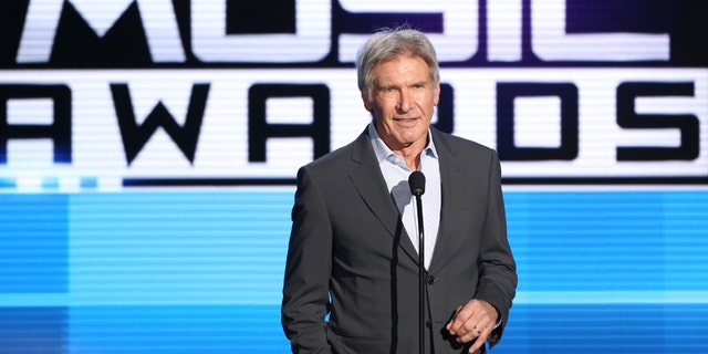 Harrison Ford introduces a performance by Pentatonix at the American Music Awards at the Microsoft Theater on Sunday, Nov. 22, 2015, in Los Angeles. (Photo by Matt Sayles/Invision/AP)