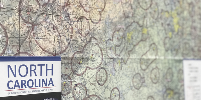 A map of North Carolina's aeronautical search and rescue chart hangs on a wall in the hangar at the U.S. Army National Guard Base in Raleigh, N.C.