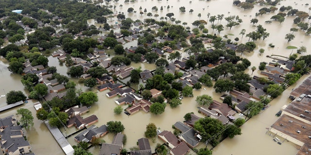 An aerial photo shows a Houston neighborhood near Addicks Reservoir that is flooded by rain from Tropical Storm Harvey, Aug. 29, 2017.
