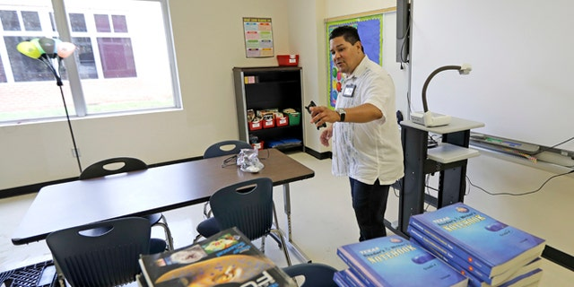 HISD Superintendent Richard Carranza walks through a classroom damaged by floodwaters at A.G. Hilliard Elementary School in the aftermath of Tropical Storm Harvey.