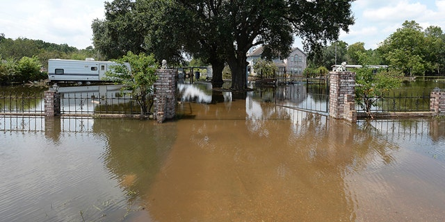 A house is seen flooded in Orange County, Texas, Sunday, Sept. 3, 2017.