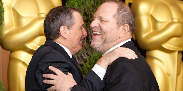 Tom Sherak (L), president of the Academy of Motion Picture Arts and Sciences, greets Harvey Weinstein, co-founder of The Weinstein Company as he arrives at the 84th Academy Awards nominees luncheon in Beverly Hills, California February 6, 2012.