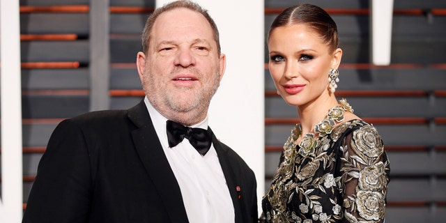 FILE -- Producer Harvey Weinstein and wife, designer Georgina Chapman, arrive at the 2015 Vanity Fair Oscar Party in Beverly Hills, California February 22, 2015.