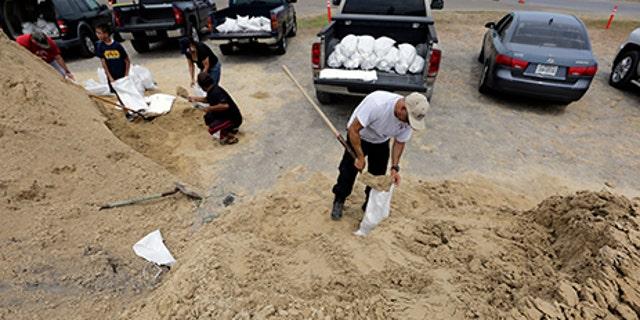 Martin Quintanilla fills sandbags as he and others prepare for Hurricane Harvey, Aug. 24, 2017, in Corpus Christi, Texas.
