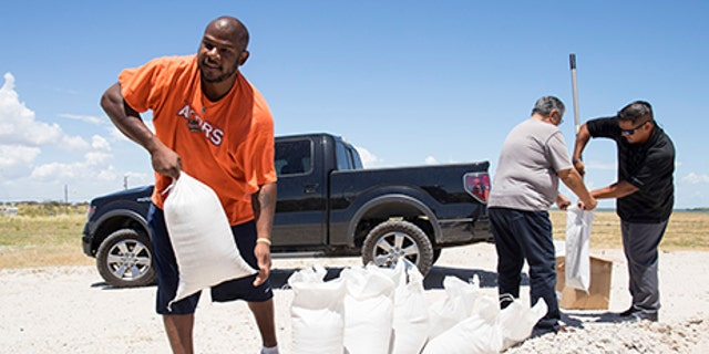 Residents fill sandbags on, August 23, 2017 to protect homes and businesses exposed by the threat of Tropical Storm Harvey.