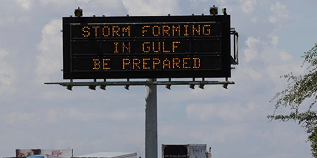 Motorists in Houston pass a sign warning of Hurricane Harvey as the storm intensifies in the Gulf of Mexico, Aug. 24, 2017.