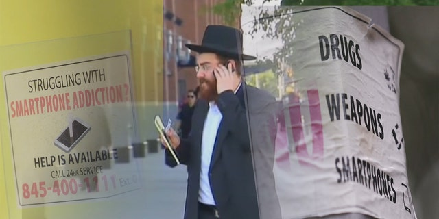 In many Hasidic enclaves, such as this one in Brooklyn, signs warning about smartphones and the Internet are common.