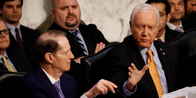 Sen. Orrin Hatch, R-Utah, right, leads a four day mark-up in Senate Finance Committee of Senate GOP tax bill