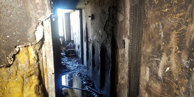 In this photo provided by KITV, fire damage from a blaze that killed three people and left 12 injured in the Marco Polo building in Honolulu is shown on Saturday, July 15, 2017.