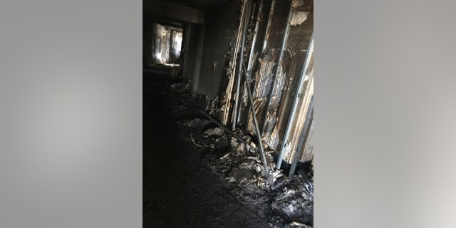 This photo provided by Bruce Campbell, a unit manager in the Marco Polo building in Honolulu, shows the charred interior of the building on Saturday, July 15, 2017.