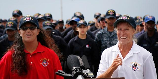 Oct. 20, 2017: Jennifer Appel, right, and Tasha Fuiava speak on the deck of the USS Ashland at White Beach Naval Facility in Okinawa, Japan.